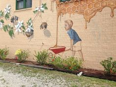 Mural by Matt Willey telling story of saving bees to feed our hungry children. Located downtown LaBelle, Florida.
