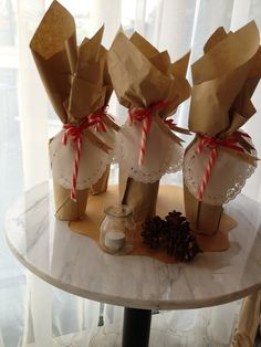 Here's a simple Christmas party favor! Wine wrapped with a candy cane! See more Christmas party ideas at CatchMyParty.com. #christmaspartyfavor #wine #christmasparty
