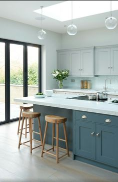Love the colours, inc pale worktop, the pendant lights and seating on two sides of the island