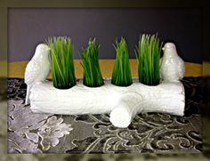 Fake grass added to candle holders for to make a center piece!