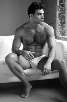 Black and white will contrast with tan. Softer shot, less intensity. Fabric adds to that element. Sideways glance. Underwear needs to be boxers.