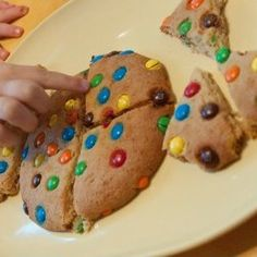 This Cookie Fraction Game is a tasty treat combines with a clever math lesson. Teach kids about fractions with their delicious dessert by slicing the cookie into different fractions. Edible crafts for kids and leartning activities for kids collide with this crafty cookie.