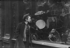 Boy looking at Christmas toys in a shop window, NYC, George Grantham Bain Collection.