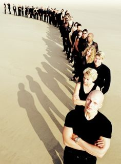 View top-quality stock photos of Group Of People Standing In Long Line On Beach Elevated View. Find premium, high-resolution stock photography at Getty Images. Large Group Photography, Line Photography, Corporate Photography, People Photography, Band Photos, Team Photos, Interior Paint Colors For Living Room, Groups Poster, Business Headshots