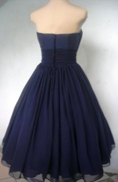A navy chiffon and ivory lace 50s cocktail dress. $285.00, via Etsy.