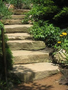As well as pokey little steps leading to other flower-drenched areas.  bistrochic.net