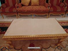 Lot 718 - Neoclassical Italian painted and parcel gilt coffee table with marble top, rope edge frame with a