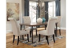 "The Tripton Rectangular Dining Room Table from Ashley Furniture HomeStore (AFHS.com). With the rustic brown finished table top supported by the aged brown color of the tubular metal legs surrounded by the beautiful button tufted upholstered chairs, The ""Tripton"" dining collection flawlessly brings together a variety of materials to create an exciting contemporary designed collection perfect for any home."
