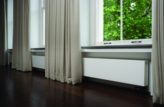 Outline radiator, long and low, fits neatly under low windows.