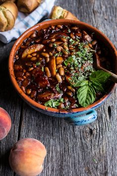 Peach and bourbon baked beans is Southern comfort in a side dish. Baked Beans With Bacon, Boston Baked Beans, How To Make Bbq, Food To Make, Sunday Recipes, Summer Recipes, Baked Bean Recipes, Beans Recipes, Savoury Recipes
