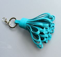 Tassel keychain in turquoise cow leather . A perfect gift