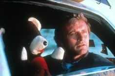 Rutger Hauer in The Hitcher - I hated that guy and that movie - it was terrifying!!!!!!!!
