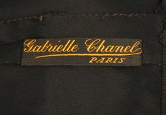 Early Chanel label, 1920s. Think she did the lousy hand-sewing herself?