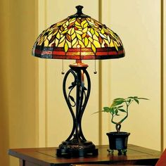 http://www.lampsplus.com/products/Blossoming-Leaf-and-Vine-Tiffany-Table-Lamp__07902.html Blossoming Leaf and Vine Tiffany Table Lamp Style # 07902