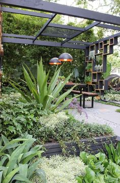 mifgs 2013 I like this look, though some of the plants don't look like low-water plants Modern garden design ideas are a process of designing and creating new ideas and plans for a perfect garden. Designing of gardens can either be done by the Back Gardens, Small Gardens, Outdoor Gardens, Modern Gardens, Outdoor Rooms, Roof Gardens, Outdoor Dining, Dining Area, Modern Garden Design