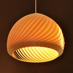 Like the stems in a field of wheat, when a light breeze is bending them, thus do the veneer strips of the Wind lampshade rest each one on its neighbor, in a soft movement, closing a circle. The Wind lampshade is made of 38 medium veneer strips. The veneer strips are translucent, showing the natural pattern of the wood. When the lamp is lit, the layers of strips and the gaps between them create a range of warm colors. http://www.mavestore.com/product/wind-lampshade-veneer-38