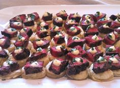 Seared beef tenderloin with horseradish cream on a puff pastry.  No recipe. Might try this christmas