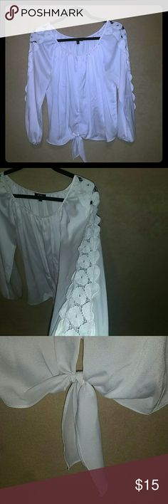 XOXO Tie Front Lace Sleeve Detail Blouse White XOXO blouse with tie in front center and see-through lace detail down both long sleeves. Elastic gather at wrist. Size small. XOXO Tops Blouses