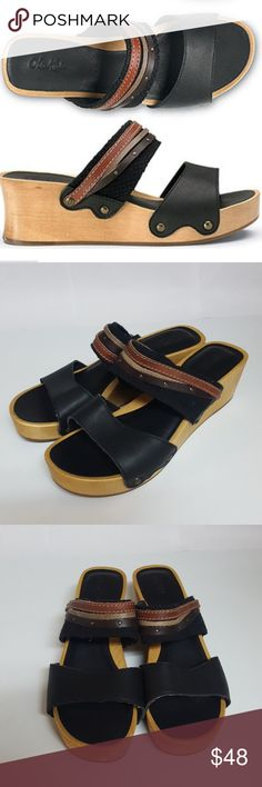 4dcf347f46c Olukai Kamola Wooden Sandals The Olukai Women's Kamola Sandals in Black /  Tan are made with