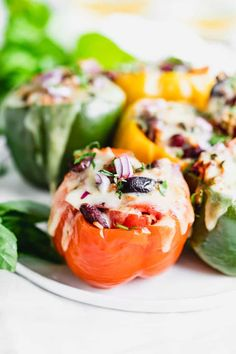 These Vegetarian Stuffed Peppers are loaded with Italian flavors and ingredients including tomatoes, basil, Fontina cheese, garlic and olives. They have 14 grams of meatless protein per pepper. #stuffedpeppers #vegetarianstuffedpeppers #italianstuffedpeppers