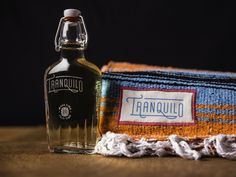This is a true tequila experience, complete with a cozy blanket and a deck  of playing cards. The Butler Bros designed this clever gift set that is  perfect for relaxing after the end of a long, exhausting year (bye, 2016!).  The bright colors of the blanket are juxtaposed with a simple, minimal  flask design for the bottle, and a traditional font gives it a rustic vibe.