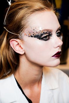 Autumn/Winter 2011-12 Couture Christian DiorGlitter, studs and sequins were used to create a striking and unique look on some models, whilst others sported neon colour-blocking on the eyes.