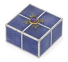 A Russian silver and transparent enamel bell push, Ivan Britsyn, St. Petersburg, 1908-1917, square, enameled in transparent lavender over a wavy guilloché ground within borders of white opaque enamel, the top centered with a gold-mounted amethyst push within green gold leaves.