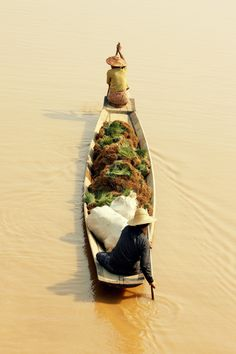 Myanmar. An awesome couple team paddling in Inle Lake.