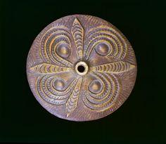 Coast Salish spindle whorl, wood