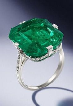 An emerald and diamond ring, by Van Cleef & Arpels, 1920. The octagonal step-cut emerald, weighing 18.67 carats, within a delicate mount millegrain-set with single-cut diamonds and engraved decoration, unsigned, numbered, French assay mark. #VanCleef&Arpels #Vintage