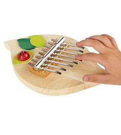 Ladybug 8-Note Thumb Piano with Smooth Wood Base by GoKids/Handelshaus Legler OHG. $19.97. No musical experience necessary!. Innovative percussion instrument. Produces a harmonic harp-like sound. For ages 5 and up. Lightweight base has a friendly little ladybug. Kids, teens, and adults all enjoy plucking a tune with their thumbs on this innovative percussion instrument - no musical experience necessary! The 8-note thumb piano produces a lovely harmonic sound rem...