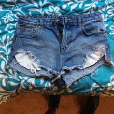 Ripped high waisted shorts Super cute to wear out! Just got too small on me but good condition. Forever 21 size 27 Forever 21 Shorts Jean Shorts
