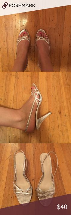 Calvin Klein silver strappy heels Strappy heels - silver snakeskin. Worn only a handful of times, good condition. Calvin Klein Shoes Heels