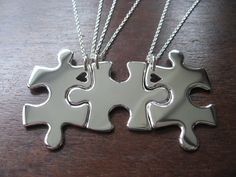 Three Puzzle Heart Pieces, Best Friends Necklace Pendants. If this wasn't $205 i would buy it in a heartbeat (: