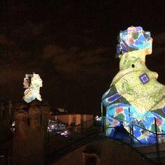 Origins light show, at night, on roof of La Pedrera