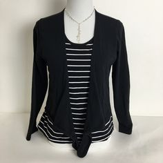 """Jones Wear top. Bundle for discount Jones Wear layered look top. Striped bottom """"layer"""" and solid black top """"layer"""" with self tie wrap.  Pre loved in good condition. Shoulders 15"""",  Chest pit to pit 19"""",  Sleeves 23"""",  Length 24"""". Jones Wear Tops"""