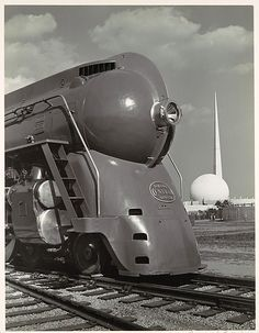 Samuel H. Gottscho (American, 1875–1971). [Locomotive, with Entrance to Perisphere of 1939 New York World's Fair in Background], ca. 1939. The Metropolitan Museum of Art, New York. Ford Motor Company Collection, Gift of Ford Motor Company and John C. Waddell, 1987 (1987.1100.96)