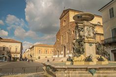 Faenza highlights: the main cathedral and fountain area of Faenza and piazza in the historic central district of the city