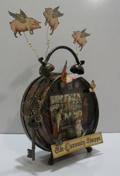 Chandon Craft News: Altered Art.Olde Curiosity Shoppe altered clock - they really do fly! Altered Tins, Altered Bottles, Altered Art, Graphic 45, Clock Craft, Clock Decor, Old Clocks, Alarm Clocks, Found Object Art