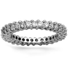 This classic womens diamond eternity band is handcrafted in lustrous 14k white gold. Round cut diamonds are prong set all the way across the band and total to 1.31 carats. The band measures to 3 mm in width and weighs 3.4 grams. $2,491.00