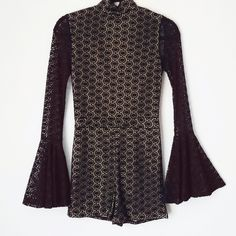 Flash Sale NWT Crochet Lace Romper Playsuit 70s inspired crochet lace fully lined Playsuit!  It has a mandarin collar and and has button closures in back of neck. The bell sleeves are the best thing about this Playsuit! It is moderate stretch. So cute with a leather jacket and booties! ***not freepeople*** Free People Dresses