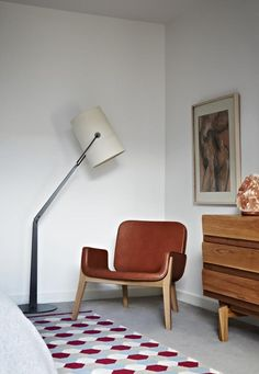 There are several armchairs in the market that will fit into your modern living area. The materials are various but all great: leather, wood, velvet, simple fabric. See our inspirations at http://goo.gl/Fiql7z