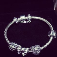 Pandora bracelet. I really want this for Christmas!