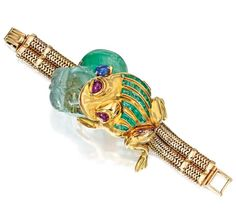 Lot 266 - 14 KARAT GOLD, GREEN BERYL, EMERALD, SAPPHIRE AND RUBY BRACELET, SEAMAN SCHEPPS
