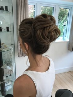 Super sexy high bun for my bride to be. Wedding hair, bridal hair Bridal Hair Updo High, Prom Hair Bun, High Bun Wedding, Bridal Bun, Romantic Bridal Updos, Wedding Hair Buns, Long Hair Wedding Styles, Bridesmaid Hair Updo Messy, Simple Bridal Hairstyle