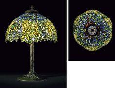 TIFFANY STUDIOS  A 'LABURNUM' LEADED GLASS AND BRONZE TABLE LAMP, CIRCA 1910