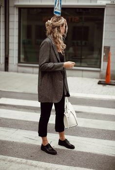 An oversized blazer feels chic and minimalist over a simple pair of black trousers.