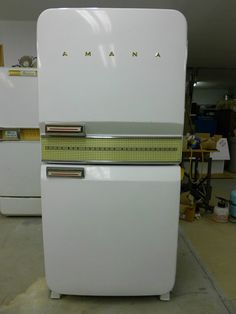 a never used 1956 Amana Stor-More refrigerator - so pretty, love the half and half setup, it even comes with display food from the showroom!