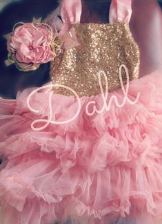 Isnt this the prettiest dress EVER!  Perfect for weddings, birthdays, photo shoots or everyday dahls wardrobes  This dress is made with a gold sequined line bodice, zipper back, pink satin straps, removable flower,with dusty pink chiffon,in a pettiskirt type design with layers of ruffles The ...