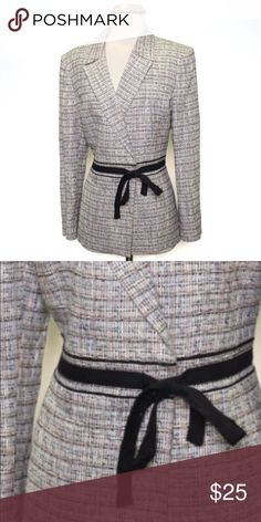 Jones Wear Ladies Blazer This is a very beautiful gently used Jones Wear brand ladies blazer. Heavy matrix just in time for the cooler weather. This is a US size 10, has a V-Neck Line, long sleeves and a decorative ribbon waisted line. The jacket has a plaid like pattern mixed with beige, tan, white, gray and black. (Retail Price $120.00)  This item ships immediately. 📦 Jones Wear Jackets & Coats Blazers